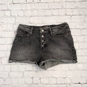 Faded black shorts with silver buttons